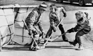 Children playing road hockey in 1976 with a homemade net.