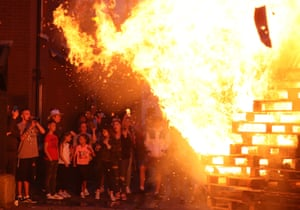 Belfast, Northern IrelandPeople attend an 11th night Bonfire as hundreds were set to be lit at midnight, as part of a loyalist tradition to mark the anniversary of the Protestant King William's victory over the Catholic King James at the Battle of the Boyne in 1690.
