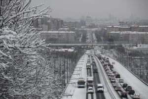 Traffic moves slowly on Monday morning after the weekend's snowstorm.
