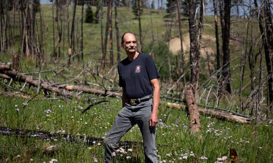Chris Finn stands where the Four Mile Fire came to the edge of Gold Hill, and where the effects can still be seen over a decade later.