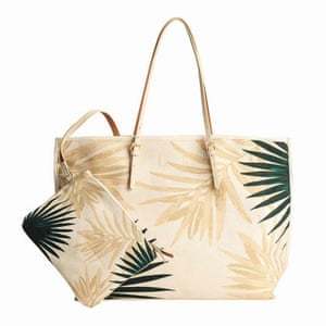 beige and green palm print beach bag with matching purse