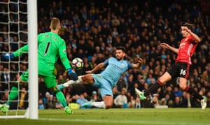 Sergio Aguero is unable to hit the target from De Bruyne's cross.