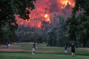 The Eagle Creek wildfire burns as golfers play at the Beacon Rock golf course in North Bonneville.