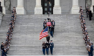 A nation in lockstep? George HW Bush's casket is transported from the US Capitol to the National Cathedral.