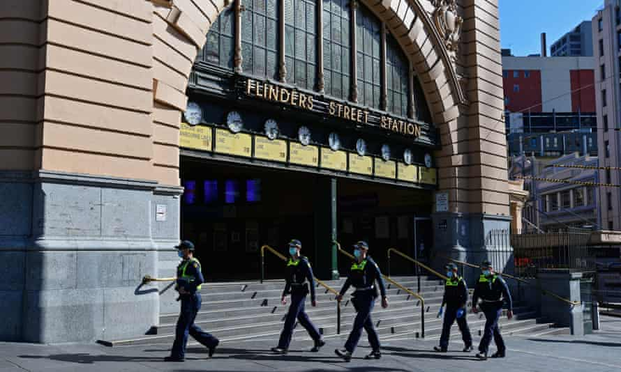 Police officers are seen outside Flinders Street Station in Melbourne.