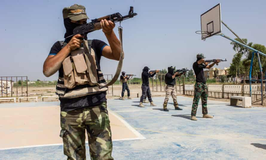 Iraqi Shia recruits in a training centre in the east of Baghdad in August 2014.