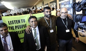 Naidoo flanked by Mohamed Aslaam (l), the minister of environmental affairs of the Maldives, and Bobby Peek, a South African environmental activist, at a demonstration during UN climate talks in Durban, in 2011.