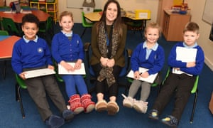 Teacher and pupils at Findern primary schools smiling and showing off their slippers