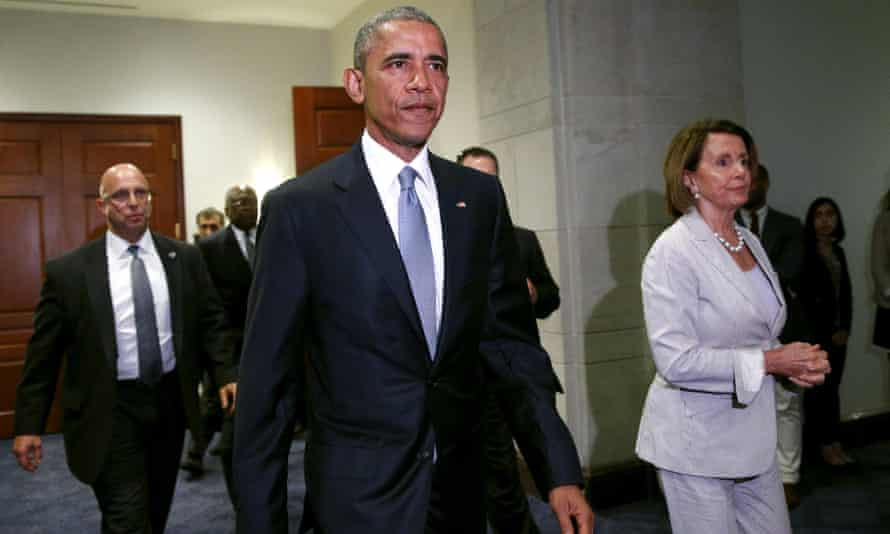 President Obama, with House Democrat leader Nancy Pelosi at his side, walks from a meeting room on Capitol Hill