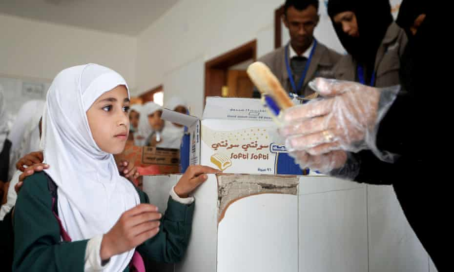 A student in Yemen receives free food