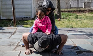 Chef Mo Major exercises with his children in Mount Vernon, New York.