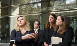 Nevada assemblywoman Michele Fiore (far left) was at federal court on Friday for the packed hearing. Outside the courthouse she read a statement from Ammon Bundy.