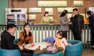 A family enjoy snacks at a cafe inside the museum of natural history in Pyongyang zoo. Pyongyang, North Korea.