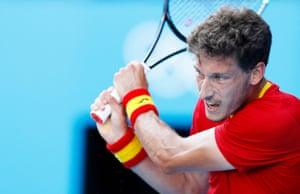 Pablo Carreno Busta of Spain fires a shot to Novak Djokovic of Serbia.