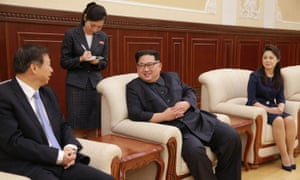 A picture released from North Korea's official news agency earlier this week shows leader Kim Jong-un, centre, with his wife Ri Sol-ju, right, and the senior Chinese official Song Tao.