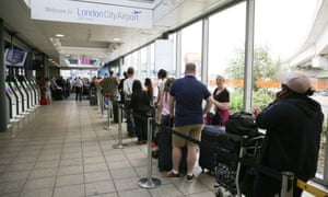 Queue of people at London City airport