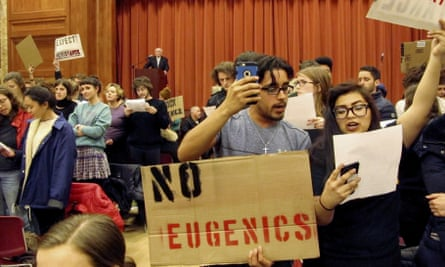 Middlebury College students turn their backs to Charles Murray, who they call a white nationalist, during his lecture.