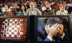 Chess enthusiasts watch World Chess champion Garry Kasparov on a television monitor in 1997.