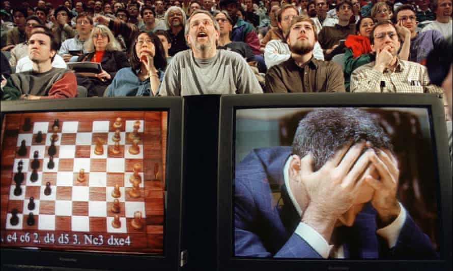 Chess enthusiasts watch Garry Kasparov on a monitor  at the start of the sixth and final match against IBM's Deep Blue computer in New York.