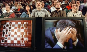Garry Kasparov holds his head in his hands at the start of his sixth and final chess match against IBM's Deep Blue computer, 11 May 1997.