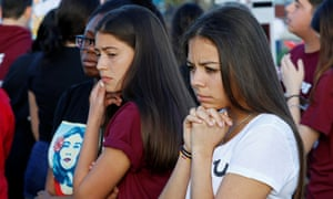 Students attend a memorial service for the victims of the Marjory Stoneman Douglas high school shooting in Parkland, Florida.