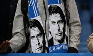 A fan wearing a scarf bearing the image of Antonio Conte during Chelsea's match against Crystal Palace.