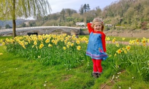 Elizabeth Spencer standing in front of daffodils