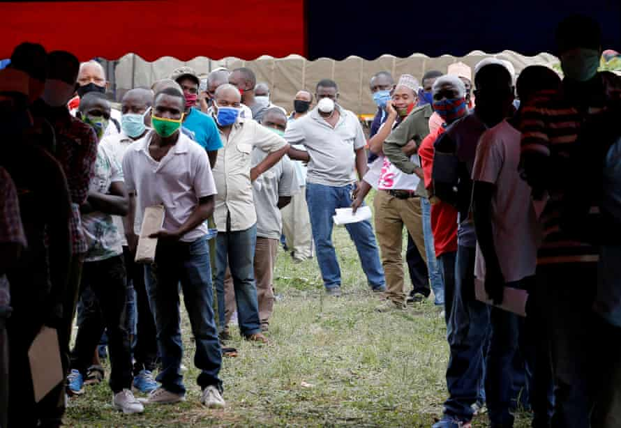 Lorry drivers queue to get tested for Covid-19 at a border crossing point between Kenya and Tanzania.