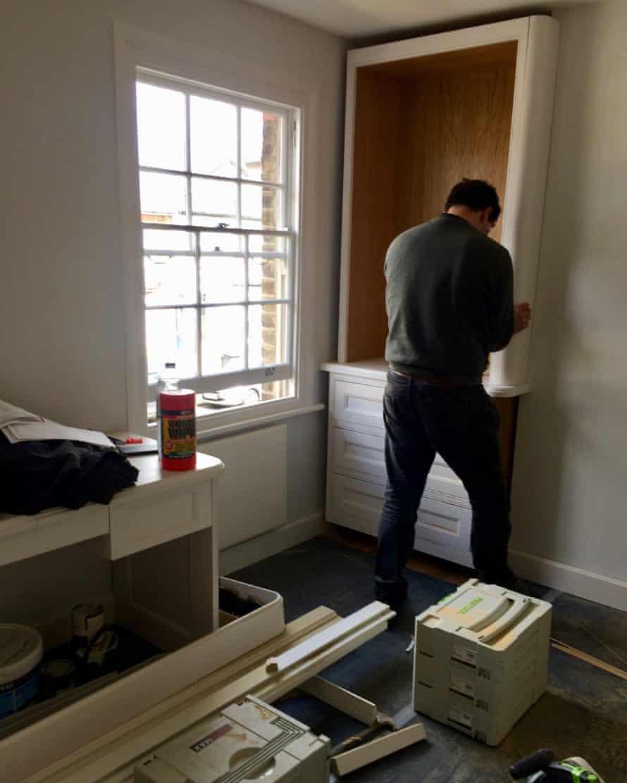 Tracey Logan's MDF wardrobe being installed.