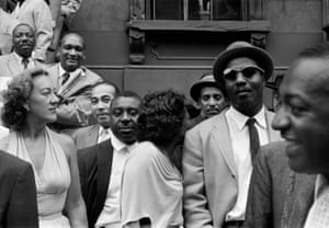 Front row, from left: Marian McPartland, Lawrence Brown, Emmett Berry, Mary Lou Williams (turned back to the camera), Vic Dickenson, Thelonious Monk. Top left, Oscar Pettiford