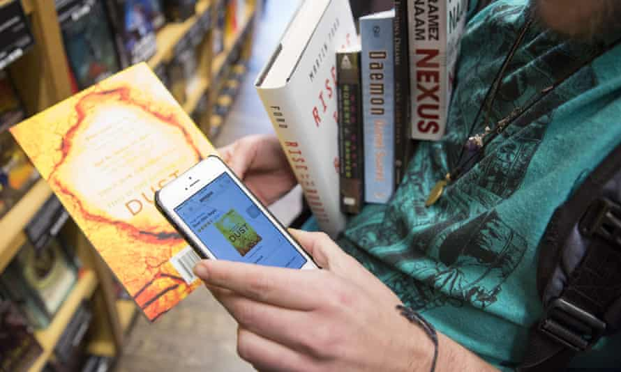 Aidan Devlon, 32, of Seattle, looks up a book on the Amazon smartphone app