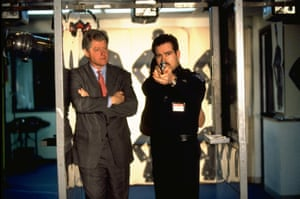Bill Clinton, then the US president, watches a student police officer at shooting practice