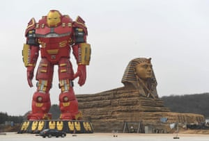 Anhui, China A giant Iron Man statue stands next to a replica Sphinx in Chuzhou