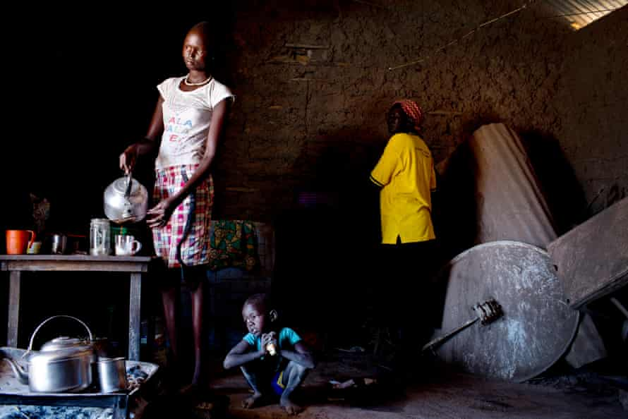 Helena, 16, makes tea to sell in her home in Rumbek, South Sudan