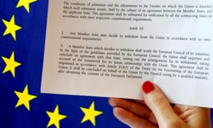 Article 50 of the EU's Lisbon Treaty is pictured near an EU flag following Britain's referendum results to leave the European Union, in this photo illustration taken in Brussels<br>Article 50 of the EU's Lisbon Treaty that deals with the mechanism for departure is pictured near an EU flag following Britain's referendum results to leave the European Union, in this photo illustration taken in Brussels, Belgium, June 24, 2016. REUTERS/Francois Lenoir/Illustration/File Photo
