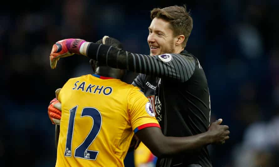 Mamadou Sakho and goalkeeper Wayne Hennessey celebrate after the final whistle.