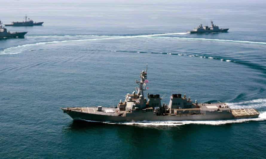 The USS Lassen (front) sailed within 12 nautical miles of the islands claimed by Beijing in the South China Sea.