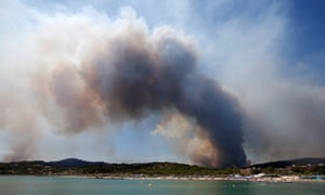 A plume of smoke fills the sky from burning fires in Bormes-les-Mimosas
