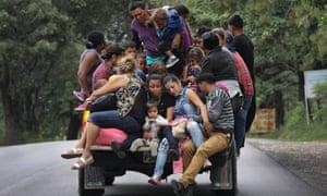 Honduran immigrants travel north near Quezaltepeque, Guatemala, on 16 October.