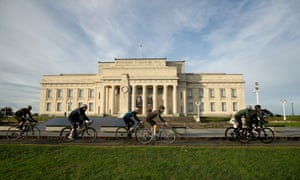 cyclist ride past Auckland war memorial museum