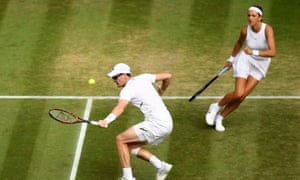 Jamie Murray returns while Victoria Azraenka watches on in the mixed doubles semi-final.