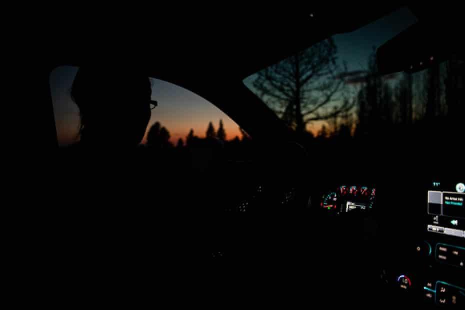 Valerie O'Dai drives her truck in the near dark in Bly, Oregon.