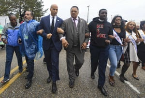 Booker and the Rev Jesse Jackson march to cross the Edmund Pettus Bridge in Selma, Alabama earlier this month.