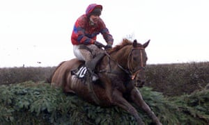 Red Marauder ridden by Richard Guest clears Becher's Brook during the infamous 2001 Grand National, when only four horses finished out of 40 starters.