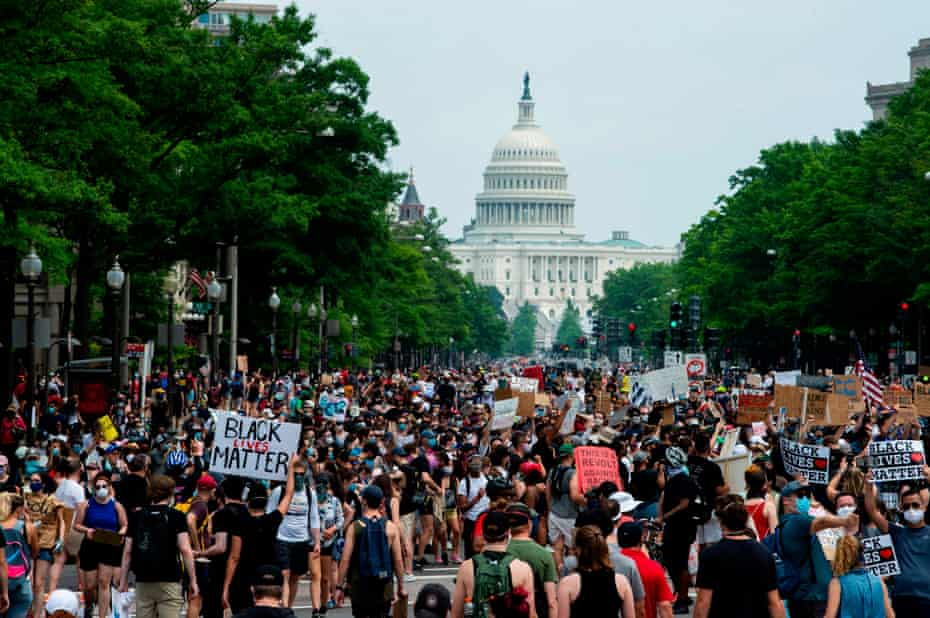 A crowd of protesters walk from the Capitol building to the White House during a peaceful protest against police brutality and racism, on 6 June 2020 in Washington DC.
