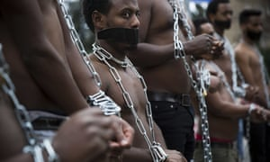 Eritrean migrants wear chains to mimic slaves at a demonstration against the Israeli government's policy to forcibly deport African refugees and asylum seekers