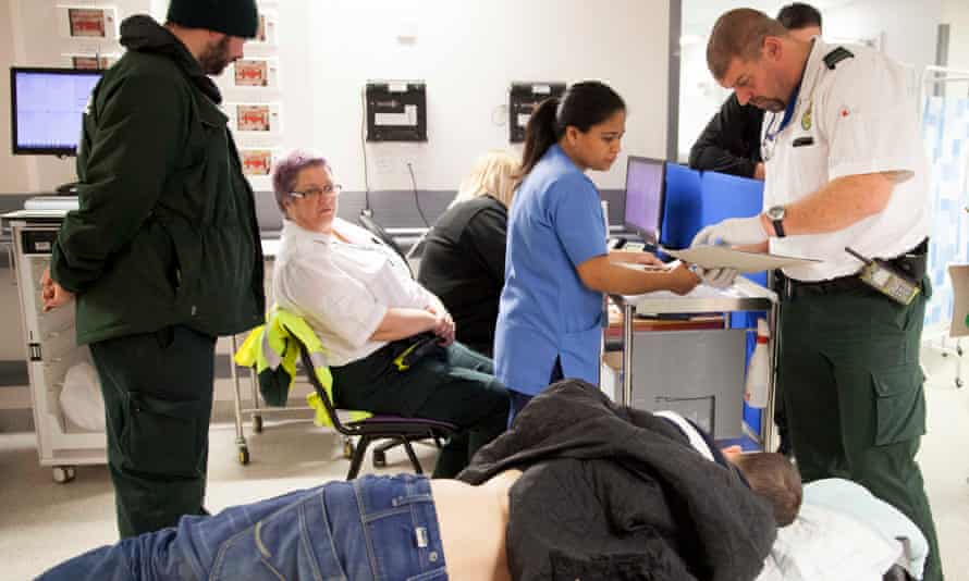 Medics with a patient in an A&E ward in Stoke