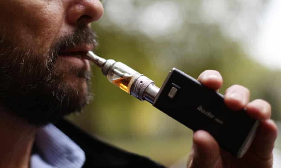 A man smoking an electronic cigarette