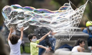 Children play with bubbles in Washington Square Park, New York City