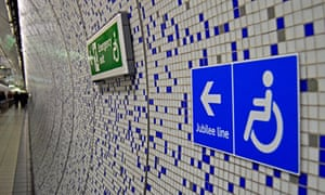 Signs indicating disabled access at Green Park underground station in London.